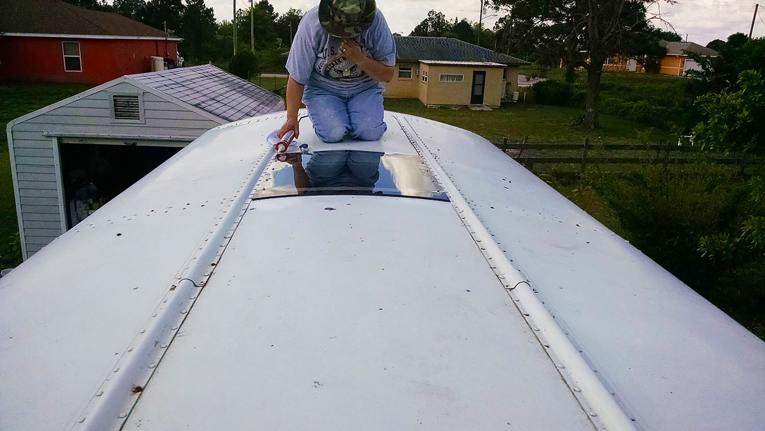 Installing the Lexan over our Skoolie escape hatches