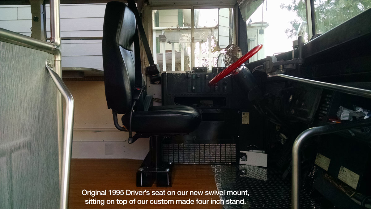 Original driver's seat mounted on swivel stand.