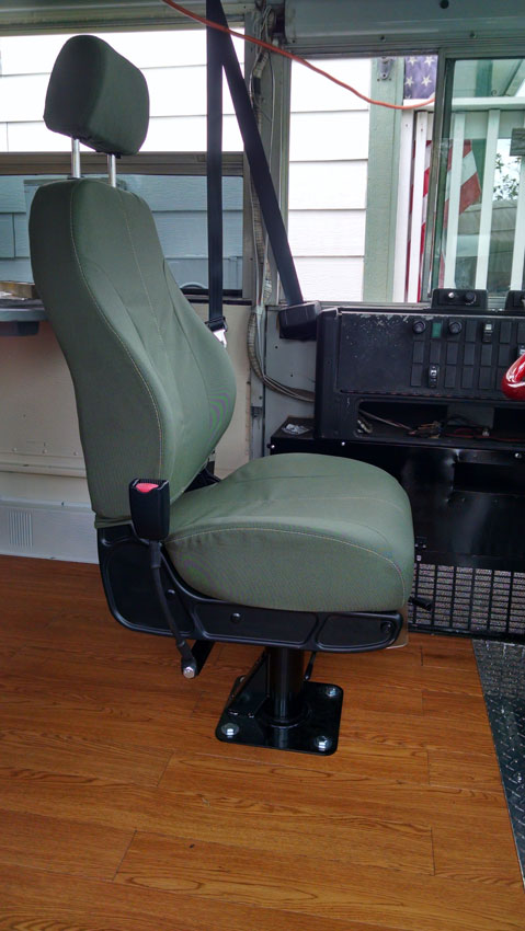 New military seat installed in the skoolie.